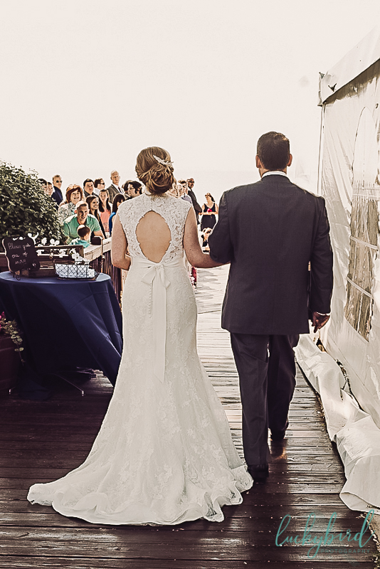 bride walking down the aisle at catawba island club