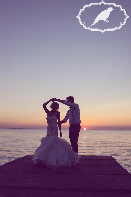 silhouette wedding photo of couple at catawba island club