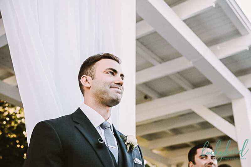 groom seeing bride walk down aisle at carranor