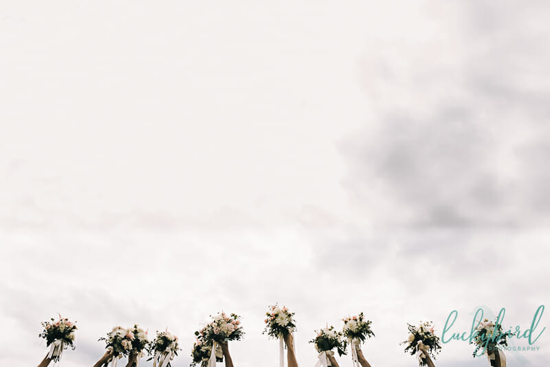 wedding bouquets in the air