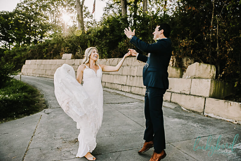bride and groom cheering at toledo country club