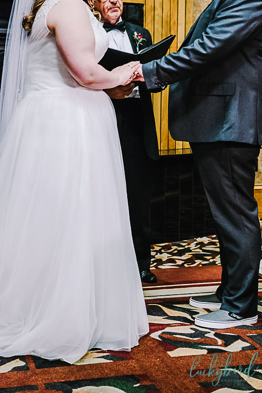 couple holding hands for pinnacle ceremony