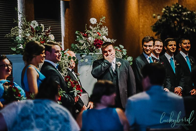 groom seeing his bride at the pinnacle indoor ceremony