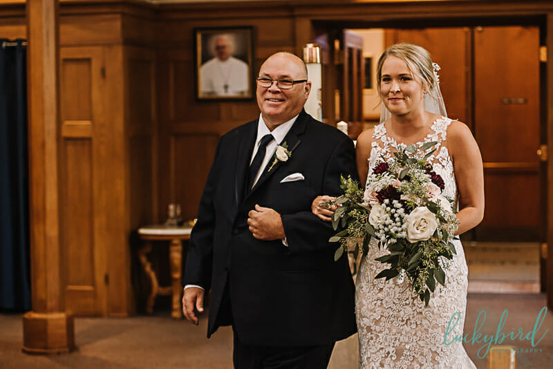 bride and dad walking down the aisle at st rose perrysburg