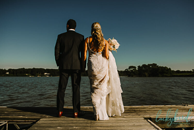 bride and groom at the docks at toledo country club