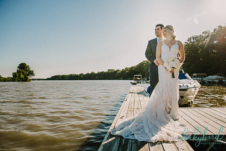 bride and groom on the docks at toledo country club