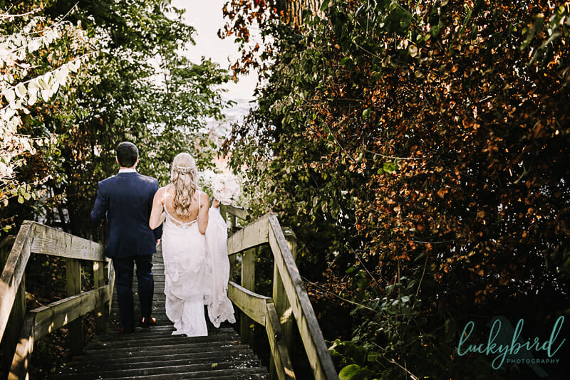 bride and groom walking down the steps at toledo country club