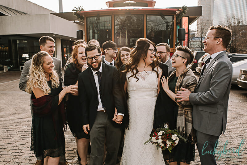 bridal party in front of trolley at renaissance toledo