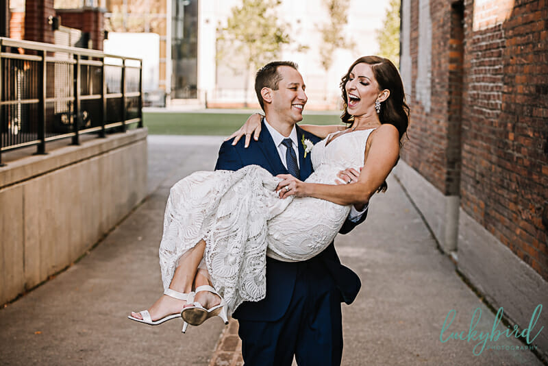 cute hensville wedding photo with groom holding bride