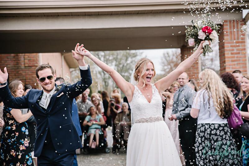 bride and groom babys breath ceremony exit