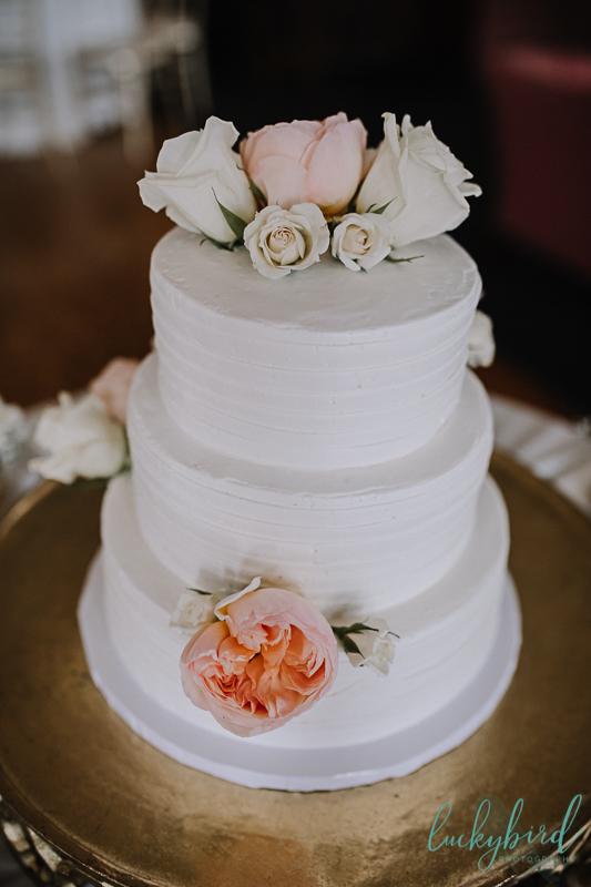 estons cake blush and ivory flowers