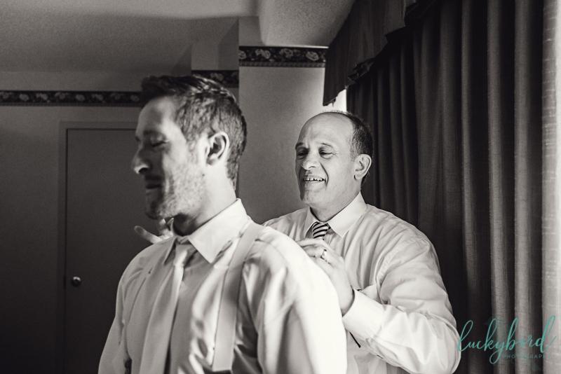 groom getting ready dad tying tie