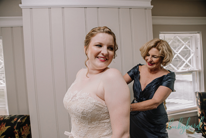 toledo country club bride getting into dress