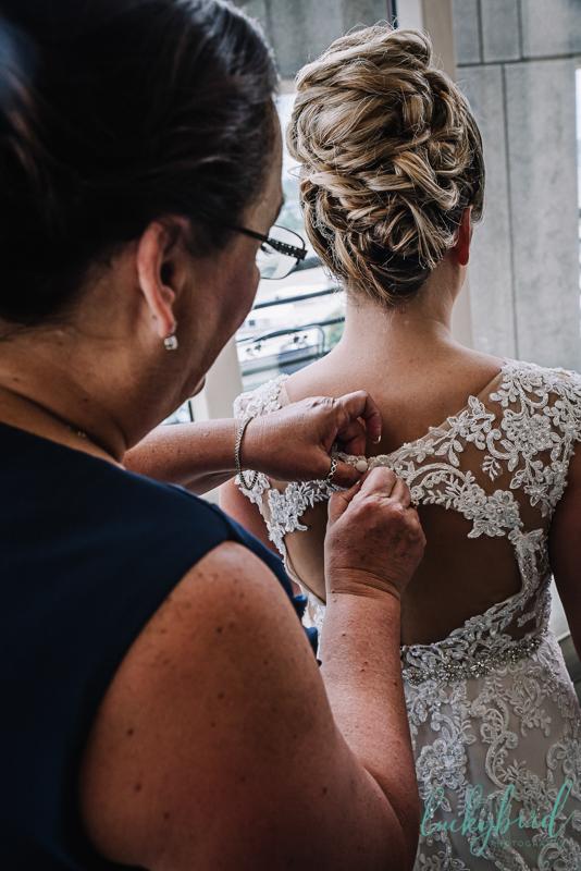 park inn bride getting ready in dress
