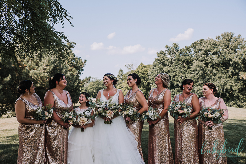 bride and bridesmaids with gold sequined dresses