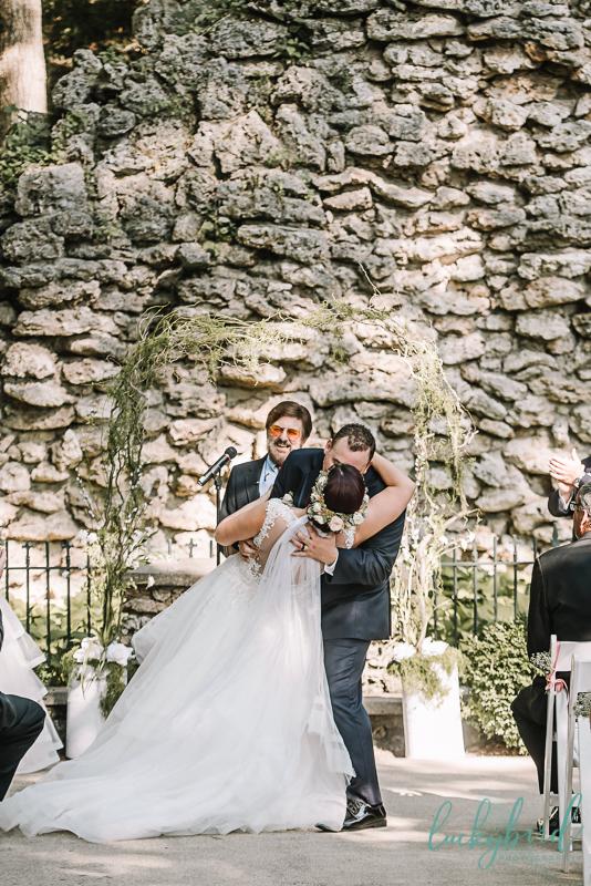 bride and groom first kiss dip nazareth hall