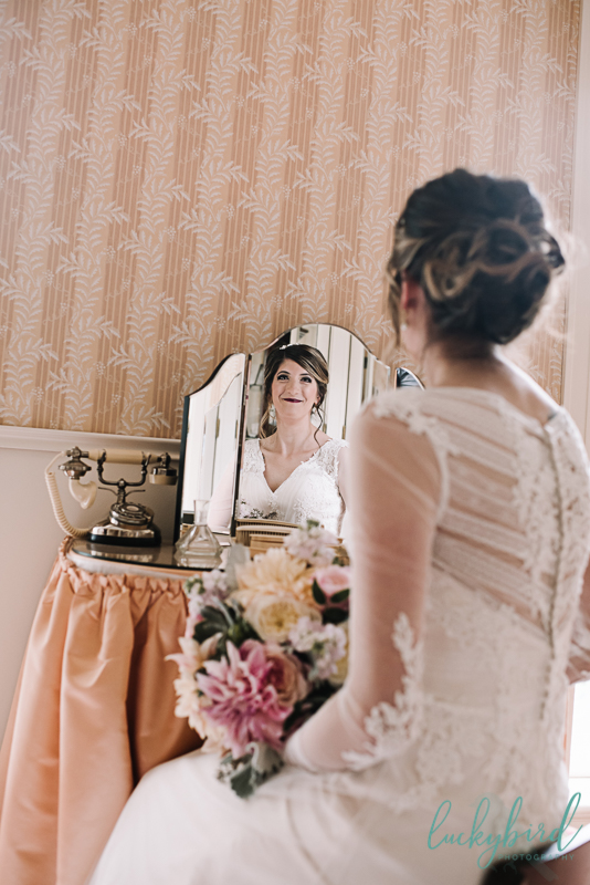 bride getting ready at the manor house