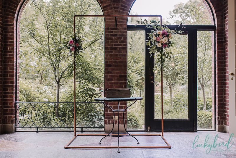 copper arch wedding centerpiece