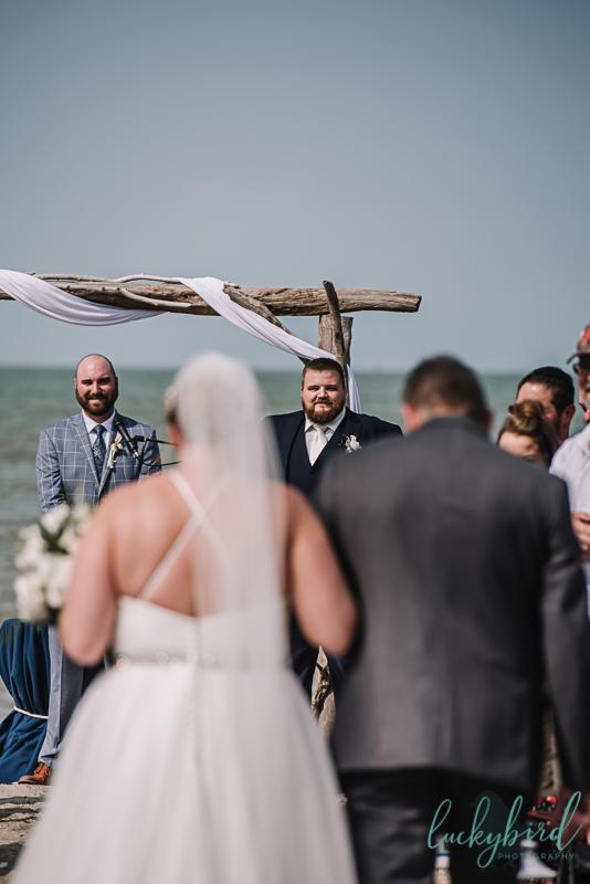 docks beach house groom seeing bride