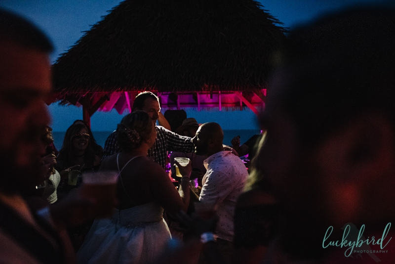 docks beach house wedding night time photo