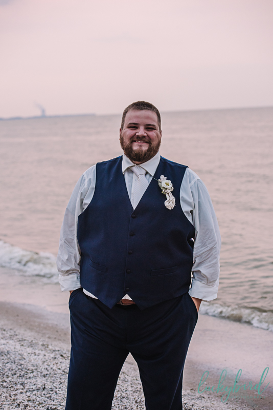 groom portrait at docks beach house