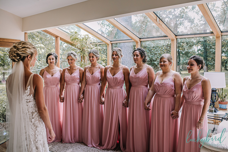 bridesmaids reveal photo with bride