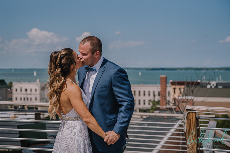 the loft rooftop wedding first look photo