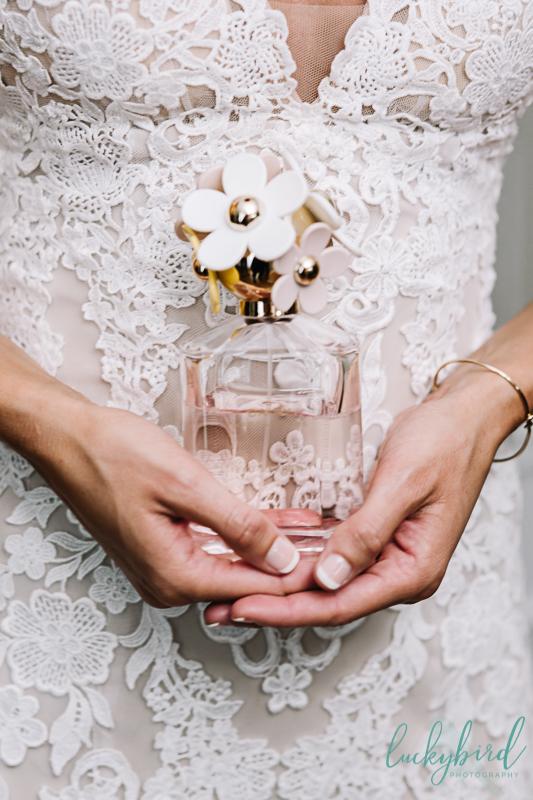 toledo bride holding her perfume
