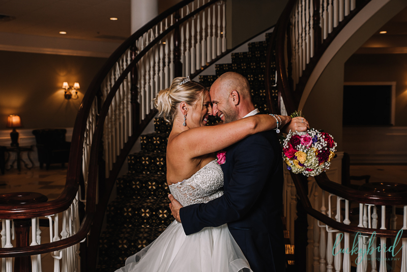 dinolfos indoor wedding photo by staircase