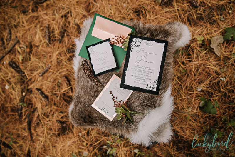 black and copper torn invitations