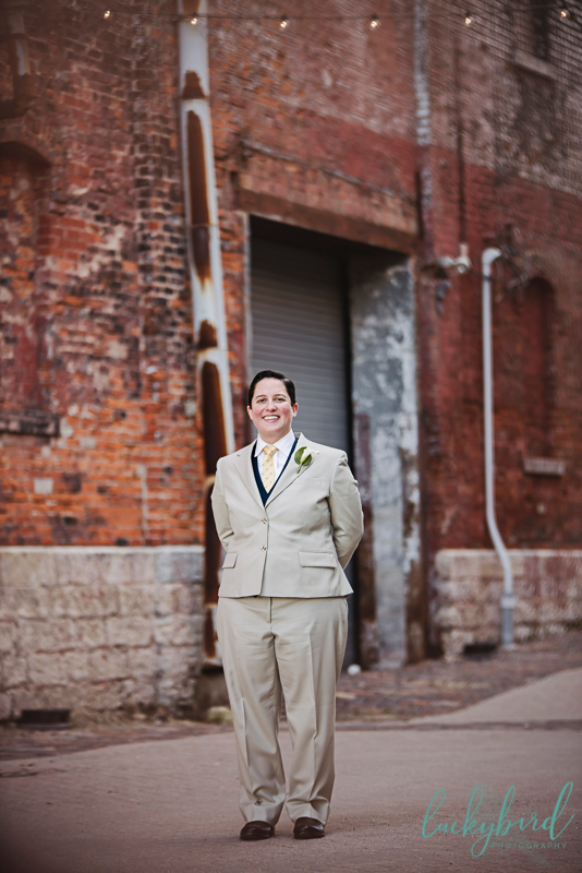columbus same sex wedding photography with bride in suit