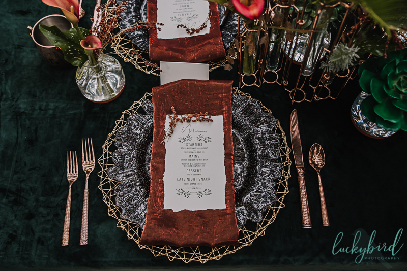 copper and gold and emerald and orange tablescape