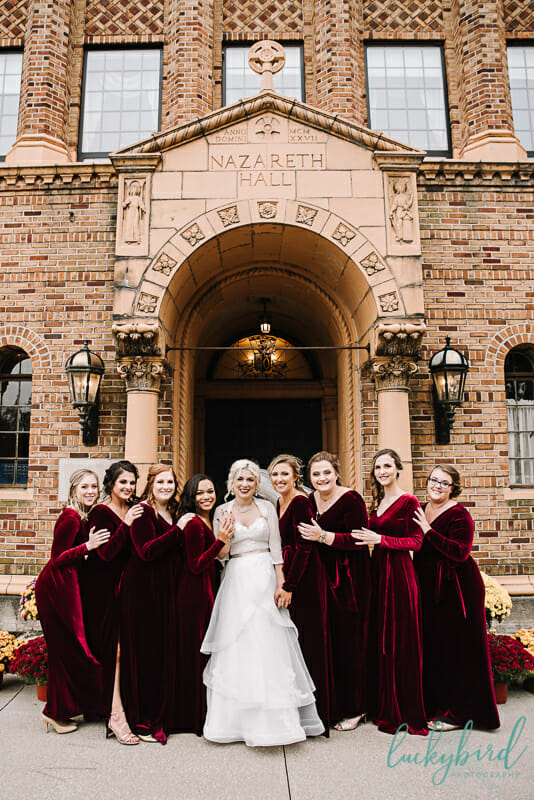 nazareth hall bridesmaids in red velvet dresses