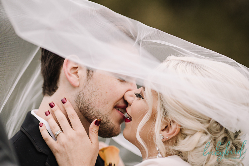 nazareth hall wedding fall photo kiss