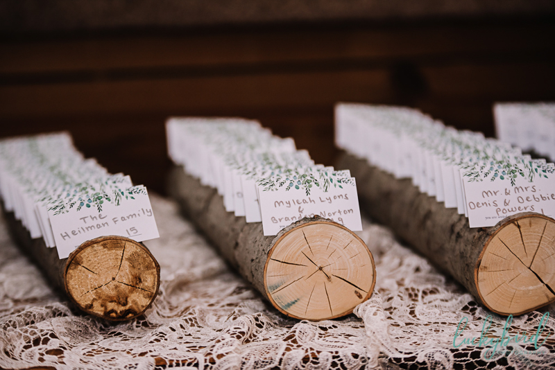 rustic placecards with tree slices the stables