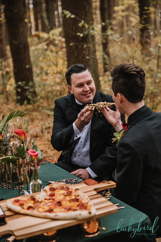 styled wedding with pizza and two grooms
