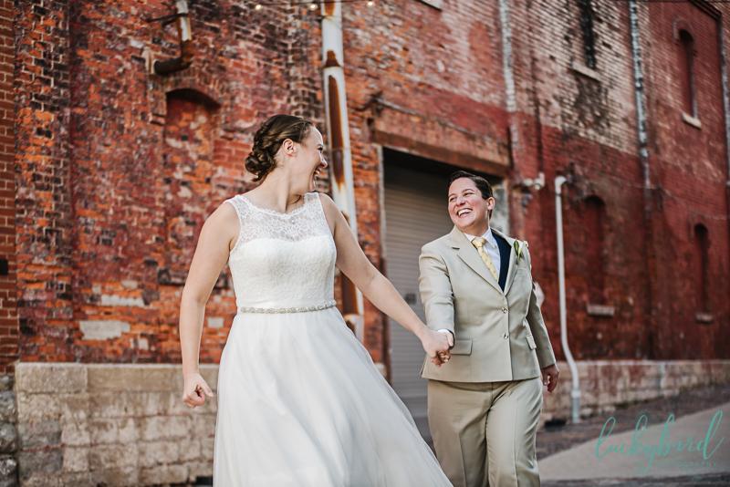 two brides having fun on wedding day