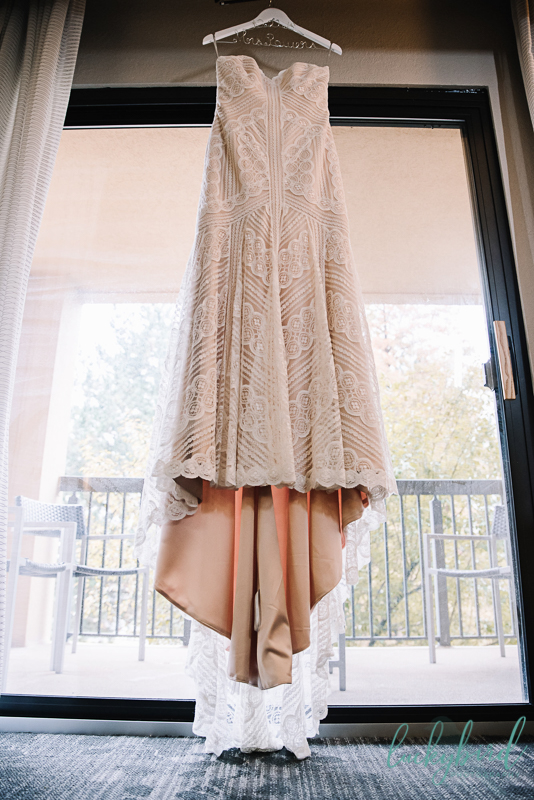 wedding dress hanging the stables