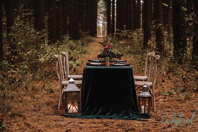 woodland styled shoot with emerald green velvet