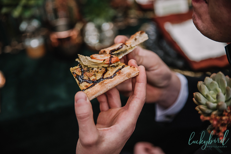 woodland styled shoot with two grooms and pizza