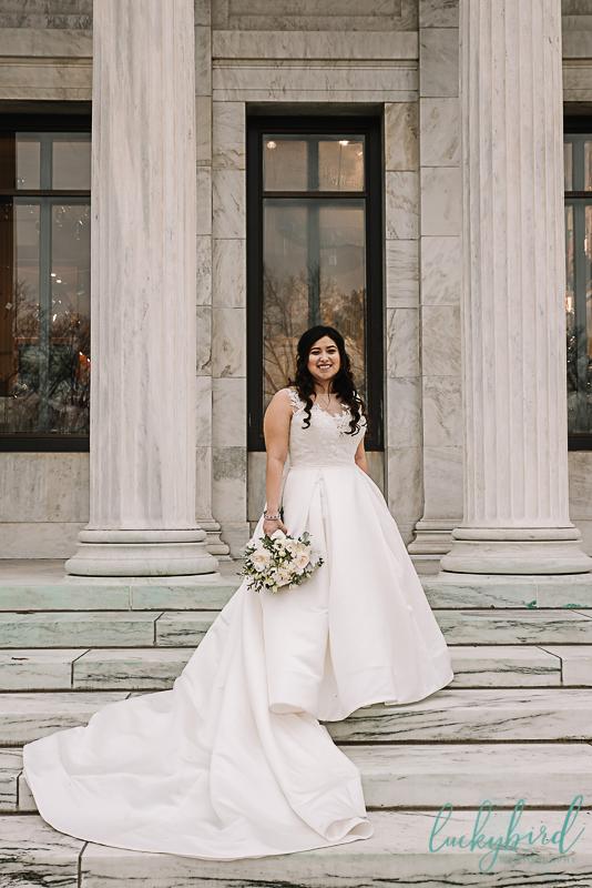 bride at toledo museum of art steps