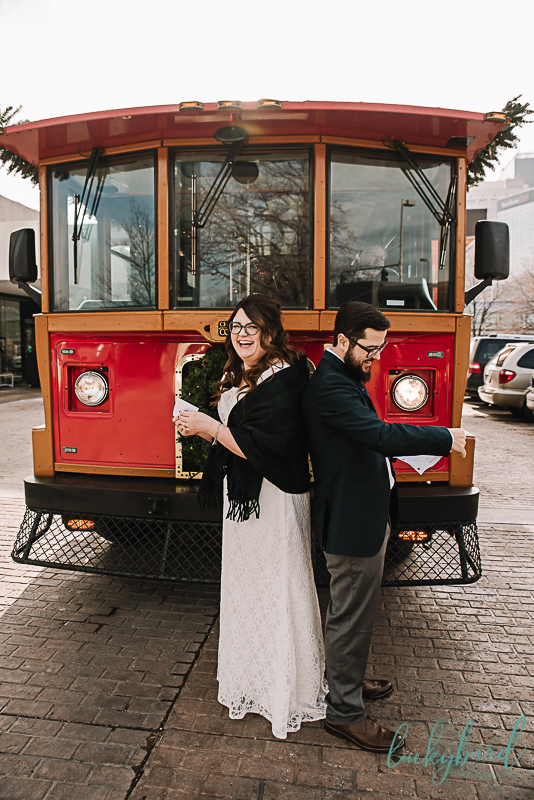 bride and groom first look in front of a trolley