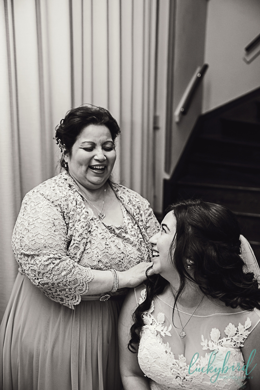 bride and mom together before a ceremony at st pats toledo