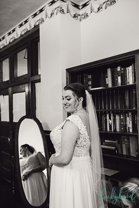 bride in her dress at nazareth hall library