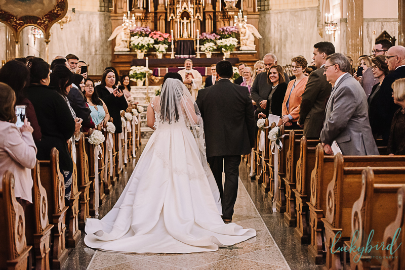 bride walking down the aisle at st pats toledo