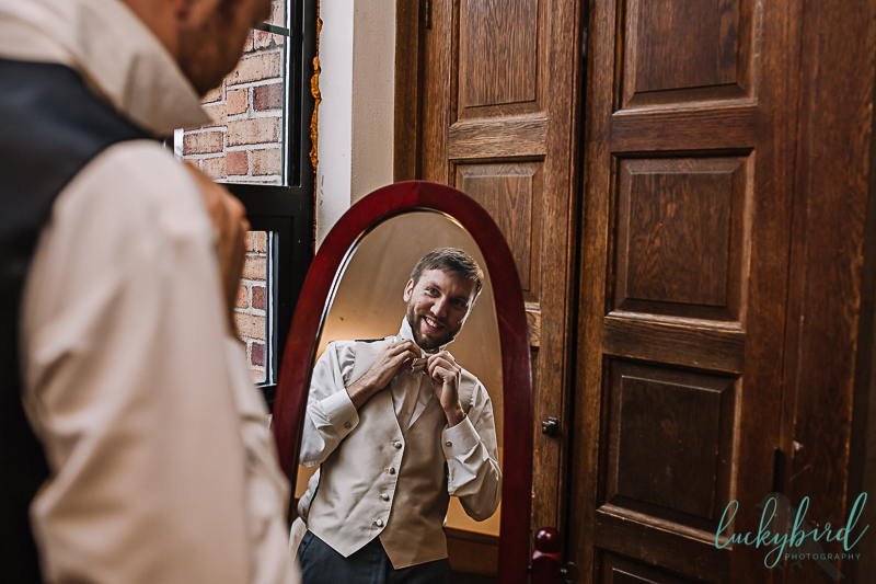 groom getting ready at nazareth hall classroom