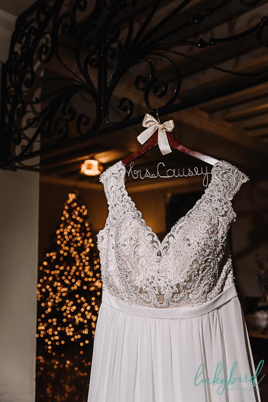winter wedding dress hanging at nazareth hall