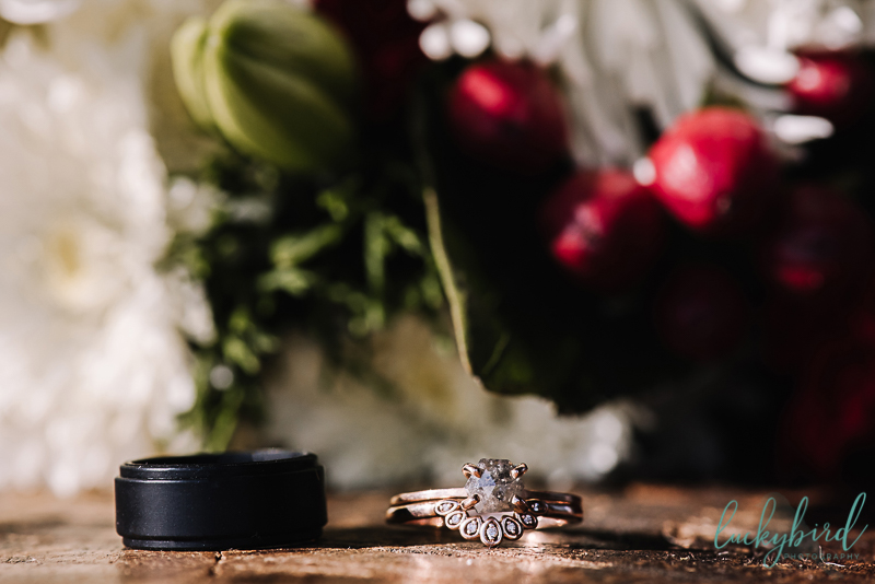 winter wedding in toledo with bouquet and rings