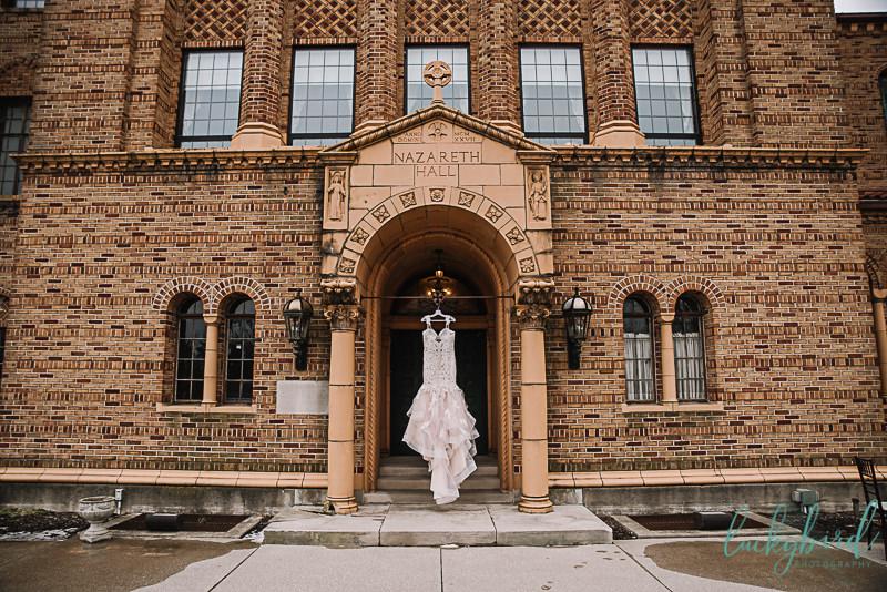 atlas bridal wedding gown hanging at nazareth hall