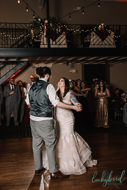 bride and groom first dance inside ladyglen ballroom